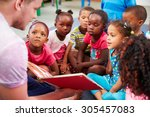 volunteer teacher reading to a... | Shutterstock . vector #305457083