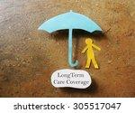 paper person under an umbrella... | Shutterstock . vector #305517047