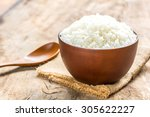 cooked rice in bowl with spoon... | Shutterstock . vector #305622227