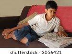 a young asian boy reading... | Shutterstock . vector #3056421