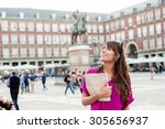 young woman tourist holding a... | Shutterstock . vector #305656937