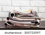 stack of magazines on table ... | Shutterstock . vector #305723597