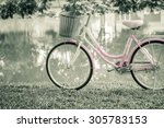 vintage bicycle beside the canal | Shutterstock . vector #305783153