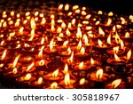Many Candles Burning At Temple...