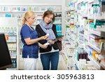 smiling female chemist holding... | Shutterstock . vector #305963813