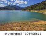 Small photo of Refreshing view of a wide mountain lake with rocky shore and pellucid blue water at Siriu lake, Buzau Mountains, Romania.