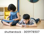 little asian boy and girl are... | Shutterstock . vector #305978507