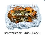 Small photo of Close up of Steamed Crab warp with Alumium Foil in the box isolated on white background
