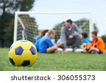 coach  and team discussing... | Shutterstock . vector #306055373