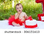 one year old girl sitting near... | Shutterstock . vector #306151613