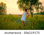 young woman with retro bicycle... | Shutterstock . vector #306219173