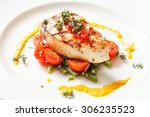 fish steak with vegetables | Shutterstock . vector #306235523