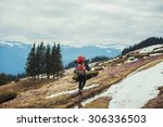 young caucasian male hiking in... | Shutterstock . vector #306336503