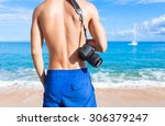 male photographer on a... | Shutterstock . vector #306379247