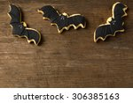 Three Bat Flying On Wood...