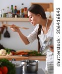 cooking woman in kitchen with...   Shutterstock . vector #306416843