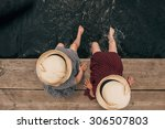 Young Girl Dipping Feet In The...