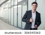 successful businessman is... | Shutterstock . vector #306545363