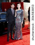 Small photo of Matt Dallas and Jaimie Alexander at the Los Angeles premiere of 'Thor' held at the El Capitan Theater in Hollywood, USA on May 5, 2011.