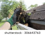 Cleaning Gutters During The...