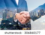 Small photo of Double exposure of business handshake for successful of investment deal and city night background