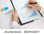 businessman counting losses and ... | Shutterstock . vector #306918347