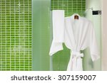 white bathing gowns hanging on... | Shutterstock . vector #307159007