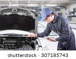 auto mechanic uses a voltmeter... | Shutterstock . vector #307185743