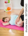 pregnant woman getting massage... | Shutterstock . vector #307284563
