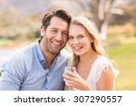 portrait of a cute couple on... | Shutterstock . vector #307290557