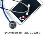 pills and stethoscope with... | Shutterstock . vector #307321253