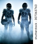 Small photo of one american football players portrait in silhouette shadow on white background