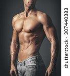 muscular male body | Shutterstock . vector #307440383