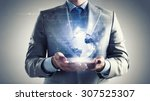close up of businessman holding ... | Shutterstock . vector #307525307