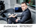 successful businessman sitting... | Shutterstock . vector #307529027