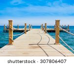jetty into the blue  | Shutterstock . vector #307806407