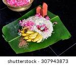 Small photo of Festivals of Kerala: Onam. Onam festival in Kerala. Offerings (aval, malar, pazham) to Thrikkakara Appan and Onathappan (Maveli) and Ganapathy on Plantain leaf. Scene from Thiruvananthapuram