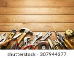variety of tools on wood planks ... | Shutterstock . vector #307944377