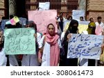 Small photo of QUETTA, PAKISTAN - AUG 20: Students of Bolan Medical College (BMC) chant slogans against college administration and their education rights during protest demonstration at on August 20, 2015.