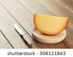 Edam Cheese And A Knife On A...