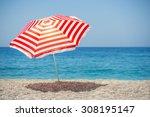 Striped Beach Umbrella On The...