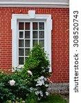 White Window On A Red Brick...