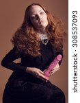 Small photo of Woman in historical dress with collar in romanticism style. With things from another era - dildo