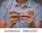 close up on a boy with a mobile ... | Shutterstock . vector #308612327