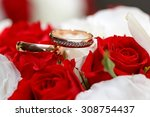 gold wedding rings on a bouquet ... | Shutterstock . vector #308754437