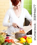 smiling young woman cutting... | Shutterstock . vector #308946677