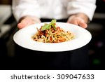 chef holding hot spaghetti to... | Shutterstock . vector #309047633