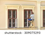 Worker Painting  The Window  ...