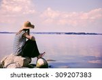 stylish woman alone sitting on... | Shutterstock . vector #309207383