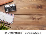 camera and supplies on office... | Shutterstock . vector #309212237
